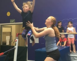 Coach Isla gives a helping hand